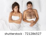 Small photo of Frustrated acrimonious female looks at boyfriend who makes annoying sound as sleeps, can`t have good dream, asks to stop it. Good looking man has health probems, interrupts girlfriend to have rest.