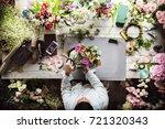 florist making fresh flowers...   Shutterstock . vector #721320343