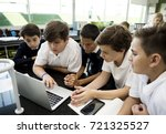 students e learning with laptop | Shutterstock . vector #721325527