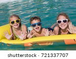 three happy children playing on ... | Shutterstock . vector #721337707