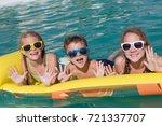 three happy children playing on ... | Shutterstock . vector #721337707