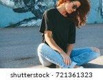 model wearing plain black t...   Shutterstock . vector #721361323