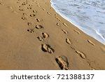 footprints in the sand | Shutterstock . vector #721388137