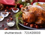tasty roasted turkey on plate | Shutterstock . vector #721420033