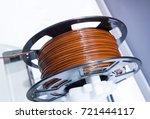 3d printing brown filaments | Shutterstock . vector #721444117