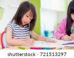 preschool girl kid drawing with ... | Shutterstock . vector #721513297