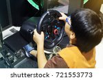 boys are playing a racing game. | Shutterstock . vector #721553773