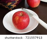 one red apple place on a white... | Shutterstock . vector #721557913