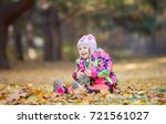 happy little girl playing with... | Shutterstock . vector #721561027