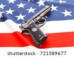 handgun over satin usa flag  ... | Shutterstock . vector #721589677