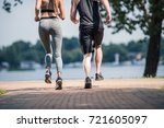 partial view of sportive couple ... | Shutterstock . vector #721605097