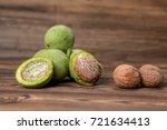 fresh harvest of walnuts on a... | Shutterstock . vector #721634413