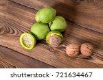 fresh harvest of walnuts on a... | Shutterstock . vector #721634467