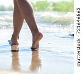 woman walking on sand beach... | Shutterstock . vector #721646863