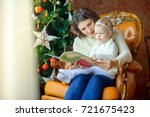 mum reads fairy tales to a...   Shutterstock . vector #721675423