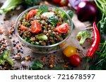 lentil grain salad with veggies ... | Shutterstock . vector #721678597