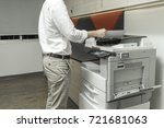 man copying paper from... | Shutterstock . vector #721681063