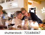 family celebrating christmas.... | Shutterstock . vector #721686067