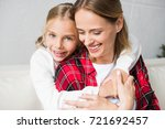 beautiful happy mother and... | Shutterstock . vector #721692457