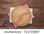 Small photo of Pizza board and tablecloth on wooden table. Top view mock up