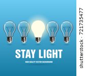 light bulbs with glowing one on ... | Shutterstock .eps vector #721735477