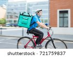 courier on bicycle delivering... | Shutterstock . vector #721759837