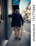 old man walking on the street | Shutterstock . vector #721772863