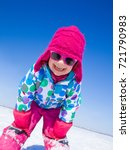 little girl playing  on snow in ... | Shutterstock . vector #721790983