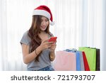 beautiful woman wearing a santa ... | Shutterstock . vector #721793707