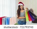 beautiful woman wearing a santa ... | Shutterstock . vector #721793743