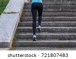 young sporty woman ascending on ... | Shutterstock . vector #721807483