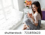 smiling young woman with cup of ... | Shutterstock . vector #721850623