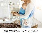 tiny sweet babyboy peacefully... | Shutterstock . vector #721921207