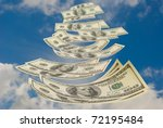 It is a lot of money (hundred - dollar denominations) to a background of the sky. - stock photo