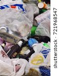 Small photo of August 21.2017-Odessa,Ukraine. The vertical proportion of the plastic garbage pollution. Bags and bottles pollute the environment. Garbage at the dump,for destruction.