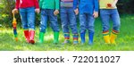 kids in rain boots. group of... | Shutterstock . vector #722011027