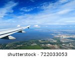 plane wing in the sky above big ... | Shutterstock . vector #722033053