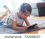 little girl holding a... | Shutterstock . vector #722048257