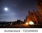 two male hikers have a rest in... | Shutterstock . vector #722104033