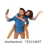 woman on the back of man waving ... | Shutterstock . vector #722113657