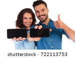 happy casual couple showing... | Shutterstock . vector #722113753