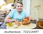 man eating knuckle of pork and... | Shutterstock . vector #722114497