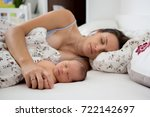 young mother sleeping with her... | Shutterstock . vector #722142697