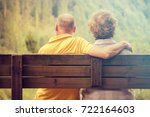 couple sitting on bench  back... | Shutterstock . vector #722164603