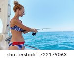 young woman with a fishing rod... | Shutterstock . vector #722179063