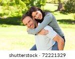 man giving wife a piggyback | Shutterstock . vector #72221329