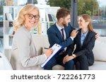 cheerful mature psychologist... | Shutterstock . vector #722261773