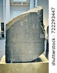 Small photo of LONDON, ENGLAND - OCTOBER 6, 2014 - The Rosetta Stone - inscription in different languages that helped decipher the ancient Egyptian hieroglyphic script