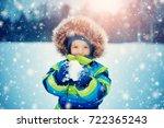Baby Boy Walking At Snowfall....