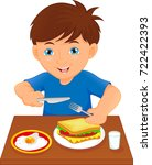 happy boy eating at the table | Shutterstock .eps vector #722422393